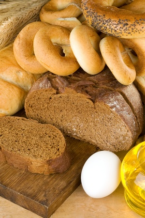 bread and bakery products on wood background photo
