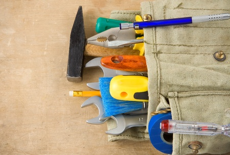 construction tools and bag on wood texture Stock Photo - 11927227