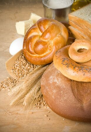bread and grain on wood background photo