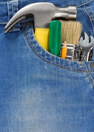 tools and instruments in blue jeans photo