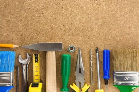 tools on wood texture background photo