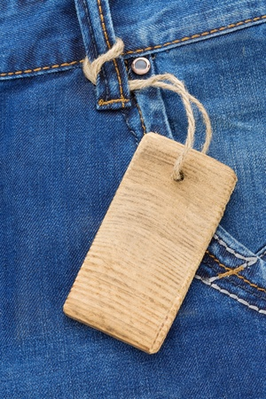 price tag over jeans textured pocket photo