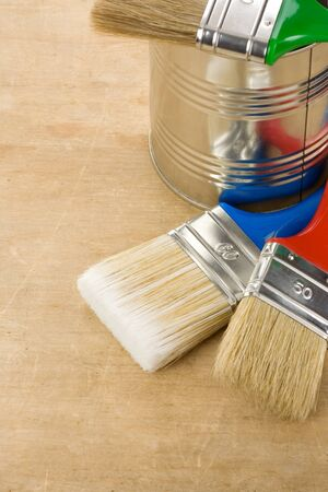 paintbrush and can on wood background texture Stock Photo - 11927251