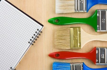 colorful paintbrush on wood background Stock Photo - 11927234