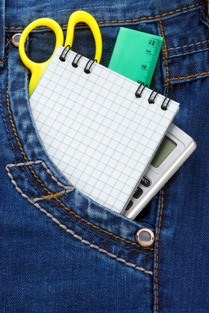 notebook and pencil in jeans packet photo