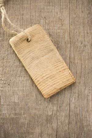 price tag over wood texture background photo