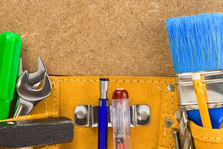 tools in belt on wooden texture photo