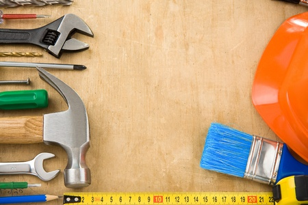 construction tools on wood texture photo