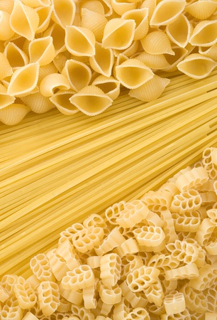 uncooked raw pasta as whole background photo