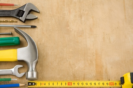 leveler: tools on wood texture background
