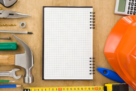 tools and notebook on wood texture background Stock Photo - 11974488