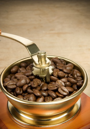 coffee beans and grinder on wood background photo
