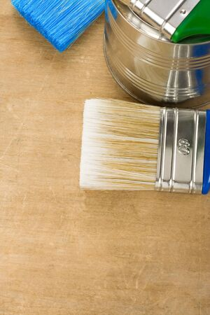 paintbrush and can on wood background texture Stock Photo - 11974519
