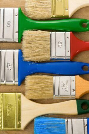 colorful paintbrush on wood background texture Stock Photo - 11974503