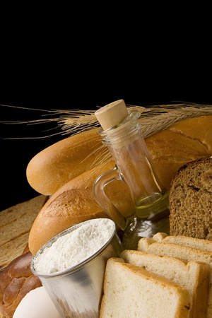 bread and bakery products isolated on black background photo