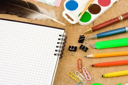 set of school accessories on wooden background photo