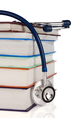 pile of books and stethoscope isolated on white background photo