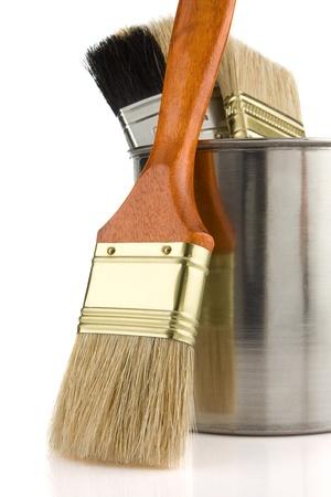 paint bucket and brush isolated on white background photo