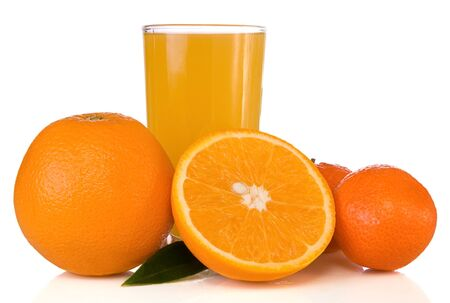 juice in glass and oranges isolated on white background photo