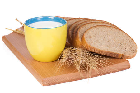 cup, bread and wooden board photo