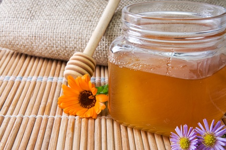 honey in glass pot near sacking Stock Photo - 12042037