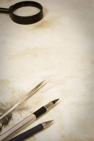 vintage image of pen and feather at paper Stock Photo - 12042103