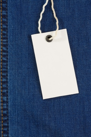 price tag over jeans background texture photo
