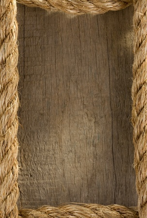 rope knot: ship rope and old wood background texture