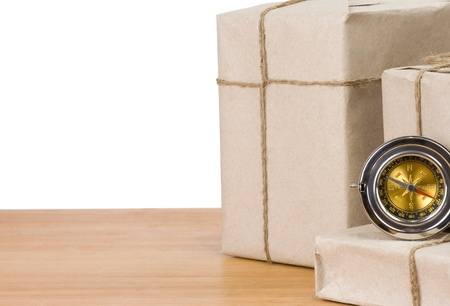 parcel wrapped and compass isolated on white background photo