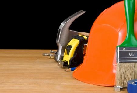 set of tools isolated on wood background photo