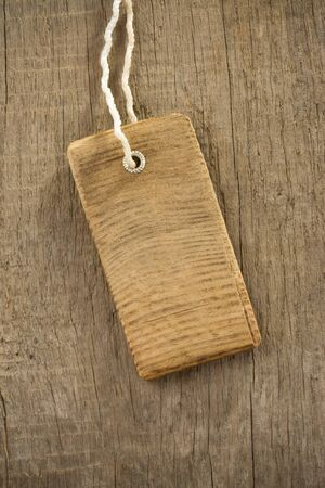 price tag over wood background texture photo