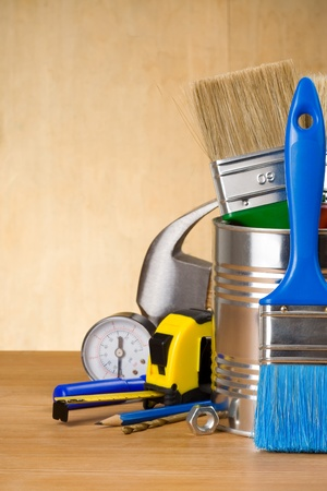 set of tools on wood background photo