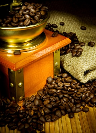 coffee grinder, beans, sacking with antique on wood  photo