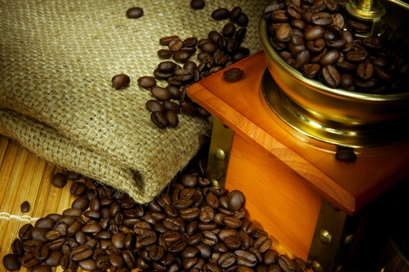 coffee beans and grinder on sacking in night photo