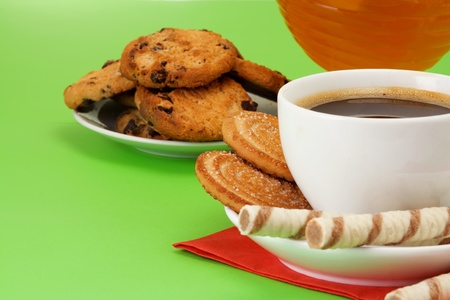 coffee, honey and cookies on green background photo