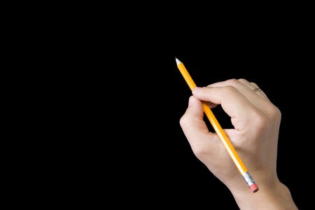 male hand writing by pencil on black background Stock Photo
