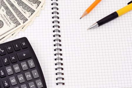 pen, pensil, calculator and dollars on checked pad Stock Photo - 12112122