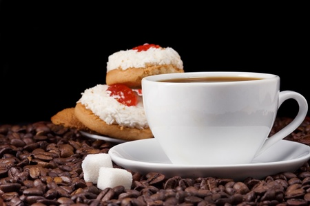 cup of coffee and sweet, cookies on beans photo