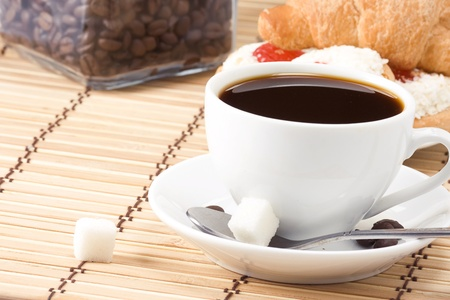 cup of coffee, beans and sweets photo