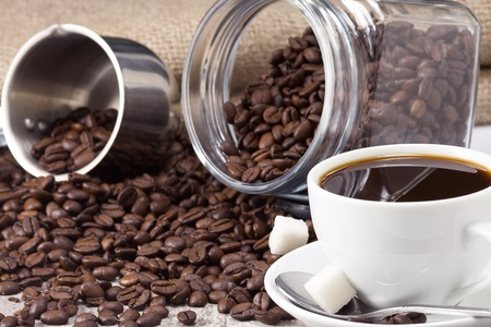 cup of coffee, pot and jar full of beans Stock Photo - 12112114