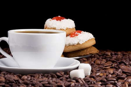 cup of coffee,  cookies and beans on black background photo