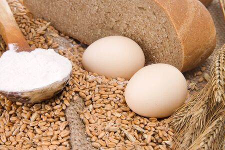 eggs, bread and wood spoon on sacking Stock Photo - 12112162