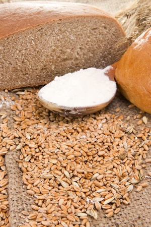 bread and wood spoon full of flour on grain Stock Photo - 12112174