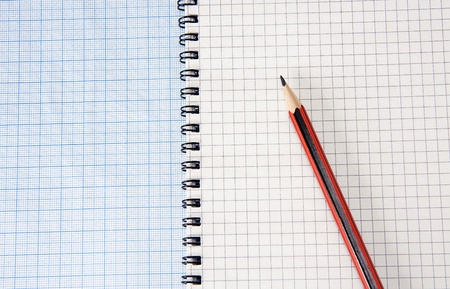 graph grid paper and notebook with pencil photo
