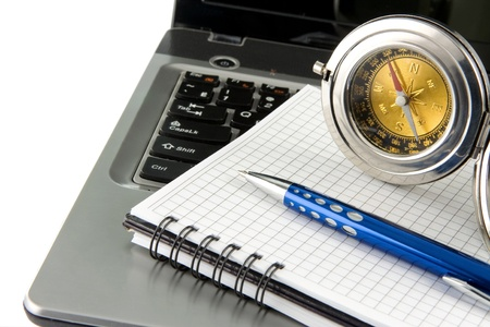 notebook laptop, compass and blue pen isolated on white background photo