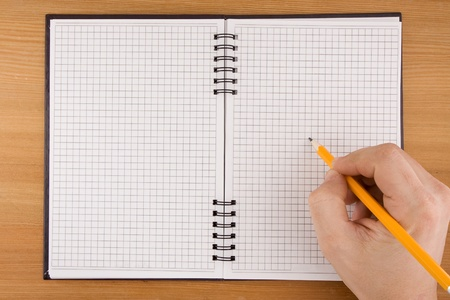 hand writing by pencil on checked notebook Stock Photo - 12311759