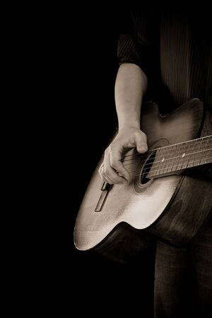 guitar and man on sepia photo