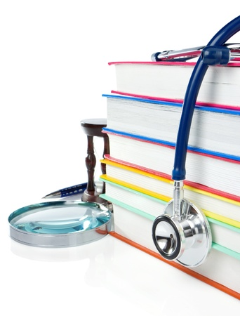 pile of books, pen and stethoscope isolated on white background Stock Photo
