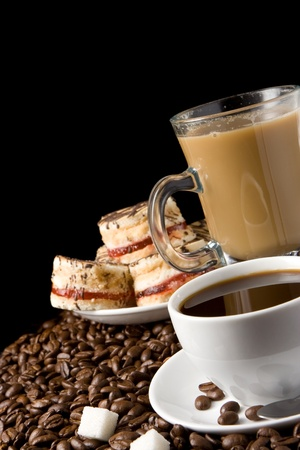 coffee and cake: cup of coffee and sweets on beans Stock Photo