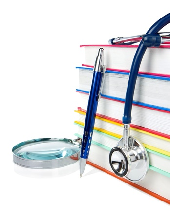 books, pen and stethoscope isolated on white background photo